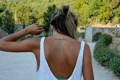 Very small upper back tattoo