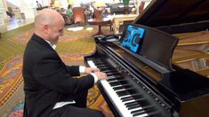 Frozen's Let it Go played by Piano John at Walt Disney World's Grand Flo...