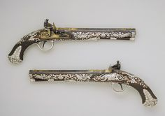 Pair of  English, flintlock pistols c1800-1801 crafted from steel, wood, silver and gold. Inspired by the French  Empire.