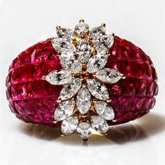 Invisibly set rubies with marquise diamond flower ring.