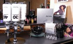 Salon Color bar using real liquor bottle dispensers for developers! Love it! Neat idea!!!