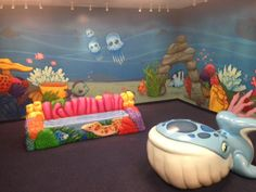 Themed kids play area and custom murals. foam sculptures. cool fun kids spaces. office designs. fun rooms.