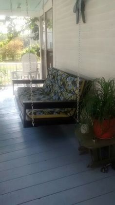 my porch swing my husband made for mea few chains an old futon frame and three store bought chair cushions it is my favorite place to kick back and relax