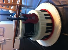Music birthday and graduation cake, with guitar drums and piano, all edible
