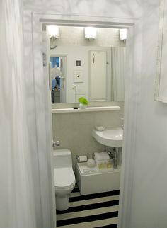 Great redo---check out the blog. TheDesignerPad - The Designer Pad - Living In 500 Sq. Feet • The Bathroom