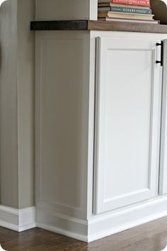 Use 12 inch top cabinets to make bottom cabinet by the fridge in kitchen.