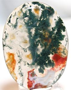 Egg shaped plume agate with green purple under water seascape moss agate thunder egg