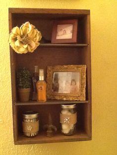Repurposed drawer into bathroom shelf....also framed kiddie bath tub pictures.