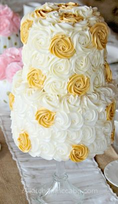 Gold and white polka dot rosette buttercream birthday cake