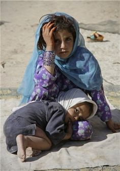 Children are always the earths shining lights....but when they are at the mercy of warring adults their light is full of fear... Afghan Refugees
