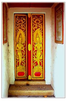 Decorative Doors leading to an above ground crypt. Thailand