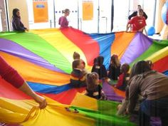 parachute game where the kids sit on the chute and the parents rotate it in a circle. Fun for strong sitters through toddlers probably. 2nd Birthday Parties, Baby Birthday, Parachute Songs, Baby Storytime, Cheer Picture Poses, Movement Activities, Baby Sensory, Cheer Pictures, Summer Activities For Kids