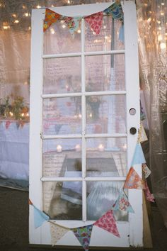ANTIQUE DOOR SEATING CHART.. love the idea.. maybe a window instead?