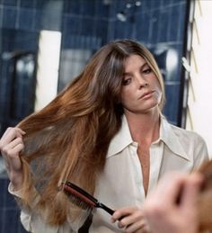 "Elaine Robinson brushing her hair in the mirror- ""The Graduate,"" 1967"