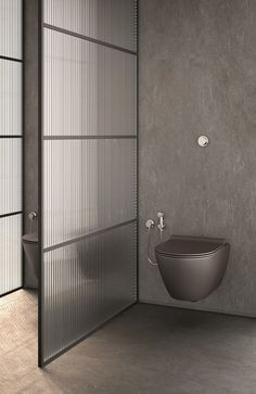 dark bathroom gives the look of masculine drama. A dark bathroom gives the look of masculine drama.A dark bathroom gives the look of masculine drama.