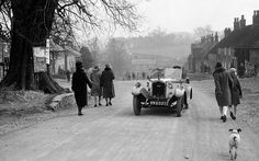 Pedestrians and a dog make way for a Rover 10/25 open four seater driven by Thackray at Coxwold North Yorks during the Ilkley and District M...