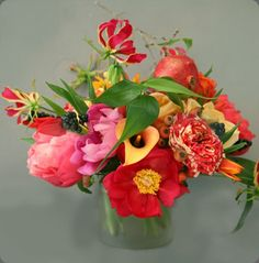 Peony, gloriosa lily, calla lily, roses make up this colorful floral arrangement by  zeze flowers