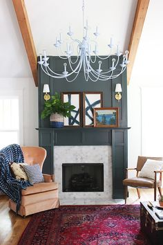 Love this home tour - the dramatic fireplace wall and art and marble tile