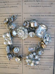 Vintage Rhinestone Button Bracelet Number 33 This bracelet has all vintage rhinestone buttons. There are so many different varieties and sizes, some with lacy bezels, some with clean setting and no prongs, some with gold tone settings, most with silver, all with various signs of age (which we love!)!...