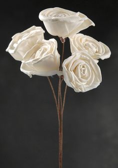 THESE ARE BEAUTIFUL!! Made out of sola wood and only 7.00 for a bunch like this! Also come in several other types of flowers!! with or without stems!!! EXTREMELY CHEAP!!!!!! TOTALLY MAKING MY BOUQUETS OUT OF THESE!! I almost spent 700.00 on fabric ones!! Now Ill get prettier ones for less than 150.00 for everyone!!