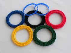 Milk Jug Rings + Yarn = Olympic Cheer by All Things Bright, via Flickr
