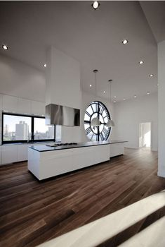 Clocktower Apartment: Most Expensive Kitchen in Brooklyn- The building and tower itself date back to 1915, with the top later converted into a whopping 6500-square-foot loft that looks out in all directions.And so it is with this project by Minimal USA, a partial renovation in DUMBO on the waterfront, in the most luxurious residence the area has to offer (valued at 25 million dollars).