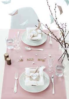 Lovely pink place settings. The Scrabble tiles are a nice, personal touch.