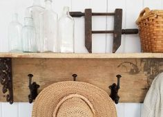 Rusty farmhouse tools are perfect paired with reclaimed barn wood to make rustic functional decor. Just grab a wire hanger, Ball jar, and a DIY attitude.