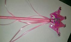 """Target dollar bin magic wand with glitter glue initial and dollar tree """"jewels"""", also I added extra ribbon....party favor for princess theme birthday"""