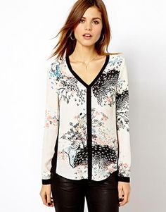 Just bought this - it's gorgeous. Gonna wear it with a fake black leather skirt or skinny black jeans.