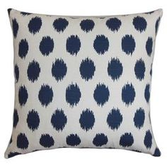"""Cotton throw pillow in navy with an ikat dot motif and feather-down fill. Made in the USA.  Product: PillowConstruction Material: Cotton and polyesterColor: NavyFeatures:  ReversibleInsert includedClean knife-edge finishMade in the USA Dimensions: 18"""" x 18""""Note: Dry cleaning recommended"""