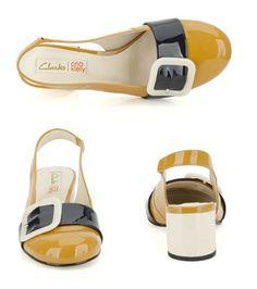 Das Design der Orla Kiely Schuhe greift den Colour Blocking Trend auf, hier werden unterschiedliche Kontrastfarben wie Senfgelb mit Dunkelblau und Weiß kombiniert. #OrlaKiely