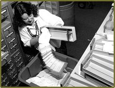 """Tossing the Card Catalog"" in 1985 at Aquinas College, Michigan -- ""The Woodhouse library went from its old card catalog system to a computerized automated system thanks to a $350,000 grant from the Grand Rapids Foundation."""