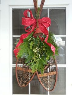 Snow shoes this year. Christmas Planters, Christmas Door Wreaths, Christmas Arrangements, Christmas Porch, Rustic Christmas, All Things Christmas, Christmas Holidays, Merry Christmas, Country Christmas Decorations