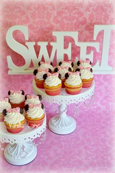 Minnie Mouse cupcakes to match the Number ONE cake I did for a first birthday.  Although the cupcakes are very simple - they just look so cute when they are done.