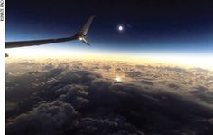 Figure 7.  A view of the totally eclipsed sun taken from an Alaska Airlines 737-900 aircraft on March 9, 2016, above the North Pacific Ocean, 700 miles north of Honolulu on March 9, 2016. A thick blanket of clouds would have obscured the eclipse from any ship, but from the aircraft's altitude of 37,000 feet, the cloud cover actually added to the spectacle. This image was taken near the end of a total eclipse that lasted 113 seconds. The clouds in the immediate foreground appear dark because…