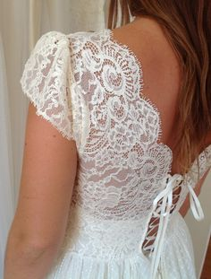 Antique vintage style Cream lace wedding dress lace up back absolutely beautiful. $1,000.00, via Etsy.
