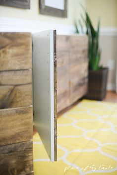 Ikea Hack: She used small trigger clamps to hold the wood panels to the door and attached the panels with wood screws.