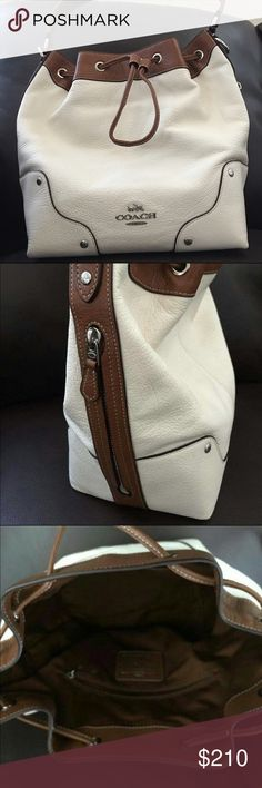 "Coach Bag Leather 2-Tone Chalk & Saddle Coach Drawstring Shoulder Bag in Spectator Leather   Color: Chalk & Saddle  Details: Bag length: 10.5"" Bag Height: 11.25"" Bag depth: 5.75"" Drawstring shoulder bag Shoulder strap 7.75"" drop Detachable and adjustable crossbody strap with 23"" drop Two tone leather in Chalk & Saddle Silver tone hardware Interior zipper pocket and two slip pockets Coach Bags Shoulder Bags"