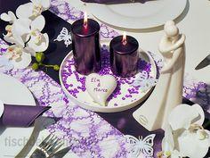 Tischdekoration zur Hochzeit in Violett mit Brautpaar-Skulptur