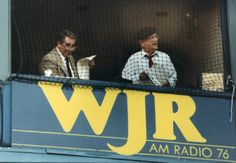 Paul Carey and Ernie Harwell in their Tiger Stadium broadcast booth, September 1991  (Dale G. Young / The Detroit News)