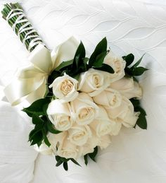 i like the dark green foliage with creme roses for maids. add dark purple for bride.