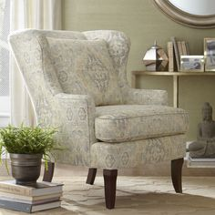 Lavelle Chair | With its enveloping shape and casual silhouette, the Cordova chair blends traditional design with exceptional comfort. Slipcovered in a subtle print fabric, the gently rounded back and soft waterfall skirt set a relaxed tone.