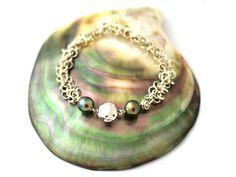 #tahiti #perledetahiti http://www.poemotu.com/perles-de-tahiti/fr/accueil-poemotu/536-bracelet-archipel-perles-de-tahiti.html