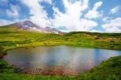 """Daisetsuzan National Park (Japan). '""""Big Snow Mountain"""" is Japan's largest national park, covering more than 2300 sq km of Hokkaidō's pristine wilderness. Serious survivalists set out to tackle the Daisetsuzan Grand Traverse. But even casual hikers can find adventure and inspiration by basing themselves in any of the park's picturesque onsen villages, and scaling a mountain or two in time for an epic sunrise or sunset.'…"""