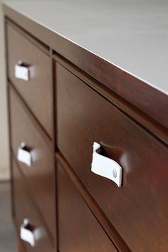 Leather drawer pulls -- this, or interesting cloth ones, are what I'm going to do to fix up a stodgy old bedroom set I'm getting from my parents' house to use in my new apt