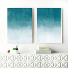 A set of two ombre abstract prints with beautiful teal and white tones, perfect for your relaxing, modern home.