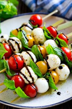 These caprese skewers combine tomatoes with basil, mozzarella, olive oil and balsamic for an appetizer that's both easy and impressive! I serve these caprese kabobs at all my parties, everyone loves this classic flavor combination Appetizers For Party, Appetizer Recipes, Appetizer Ideas, Caprese Appetizer, Easy Make Ahead Appetizers, Easy Snacks, Healthy Snacks, Caprese Skewers, Tomato Mozzarella Skewers