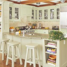 This is my favorite kitchen layout. I'm not crazy about the color of cabinets but I love everything else, the bookshelves, upper cabinets with glass, and breakfast bar.