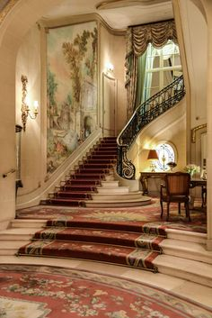 Treppe An elegant solution to building code restrictions against staircase runs over without a l Hotel Lobby Design, Grand Staircase, Staircase Design, Mansion Interior, Interior And Exterior, Lobby Interior, Mansion Hotel, Palace Interior, Interior Stairs